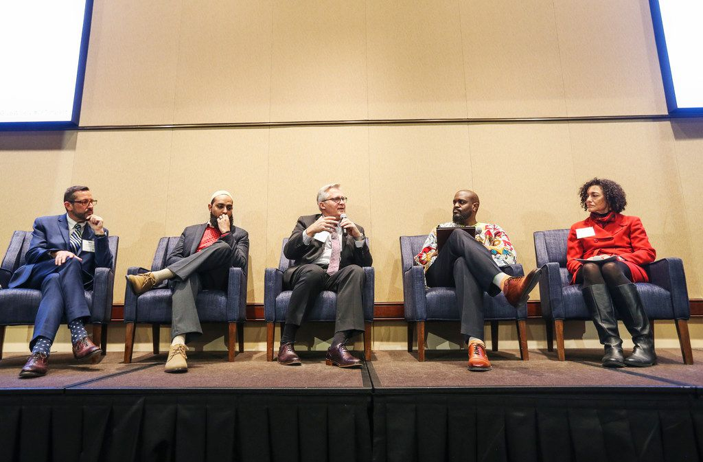From left, Neil Cazares-Thomas, Imam Azhar Subedar, George Mason, Rev. Michael Waters and Rabbi Nancy Kasten hold a panel discussion at Communities Foundation of Texas in Dallas on Dec. 4, 2018. (Carly Geraci/The Dallas Morning News)