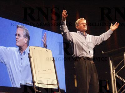 The Rev. Bill Hybels, senior pastor of Willow Creek Community Church in South Barrington, Ill., preaching at the church about managing money for a higher purpose.