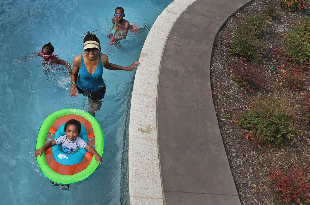 Swimmers enjoy a trip on the lazy river at JadeWaters at the Hilton Anatole Hotel in Dallas, photographed on Friday, May 26, 2017. (Louis DeLuca/The Dallas Morning News)