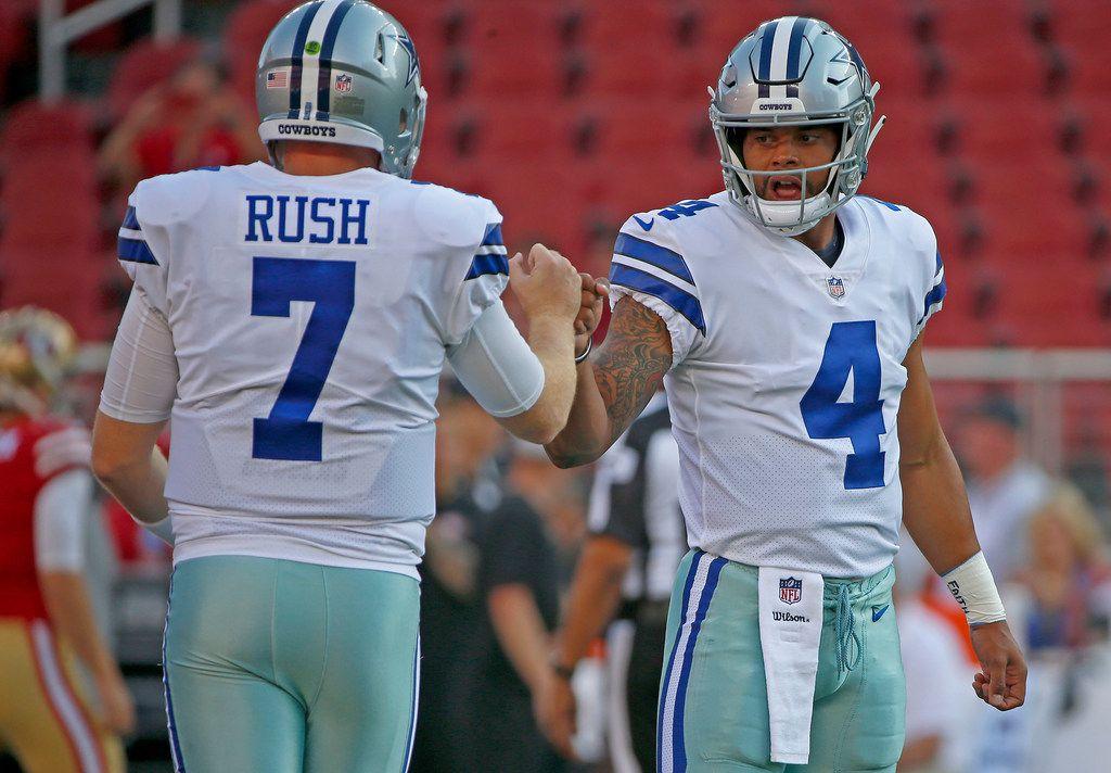 Dallas Cowboys quarterbacks Dak Prescott (4) and Cooper Rush warm up during the pre-season game against San Francisco 49ers at Levi's Stadium in Santa Clara, Calif., Thursday, Aug. 9, 2018. (Jae S. Lee/The Dallas Morning News)