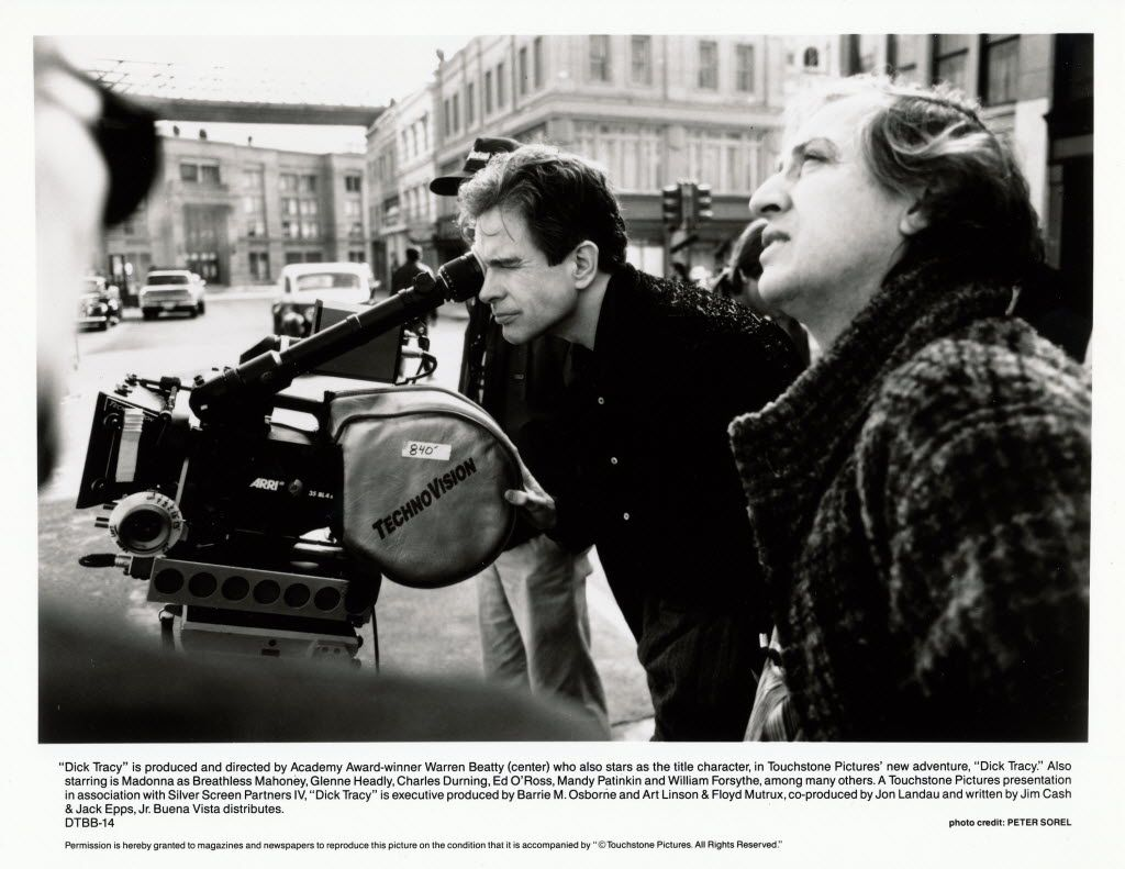 A 1990 Touchstone Pictures promotional still from behind the scenes of 'Dick Tracy,' directed by Warren Beatty