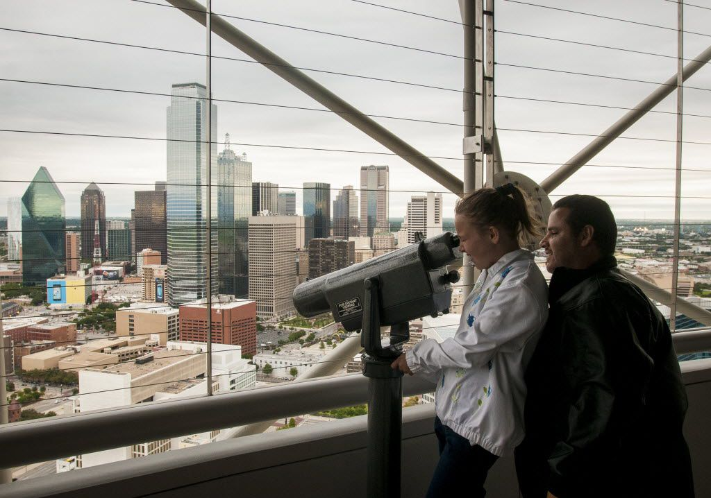 Amber Torres, 11, and her father Gilbert Torres take in the view of downtown Dallas from the GeO-Deck at Reunion Tower.