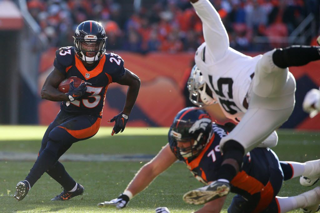 DENVER, CO - DECEMBER 13:  Running back Ronnie Hillman #23 of the Denver Broncos rushes against the Oakland Raiders during a game at Sports Authority Field at Mile High on December 13, 2015 in Denver, Colorado. (Photo by Doug Pensinger/Getty Images)