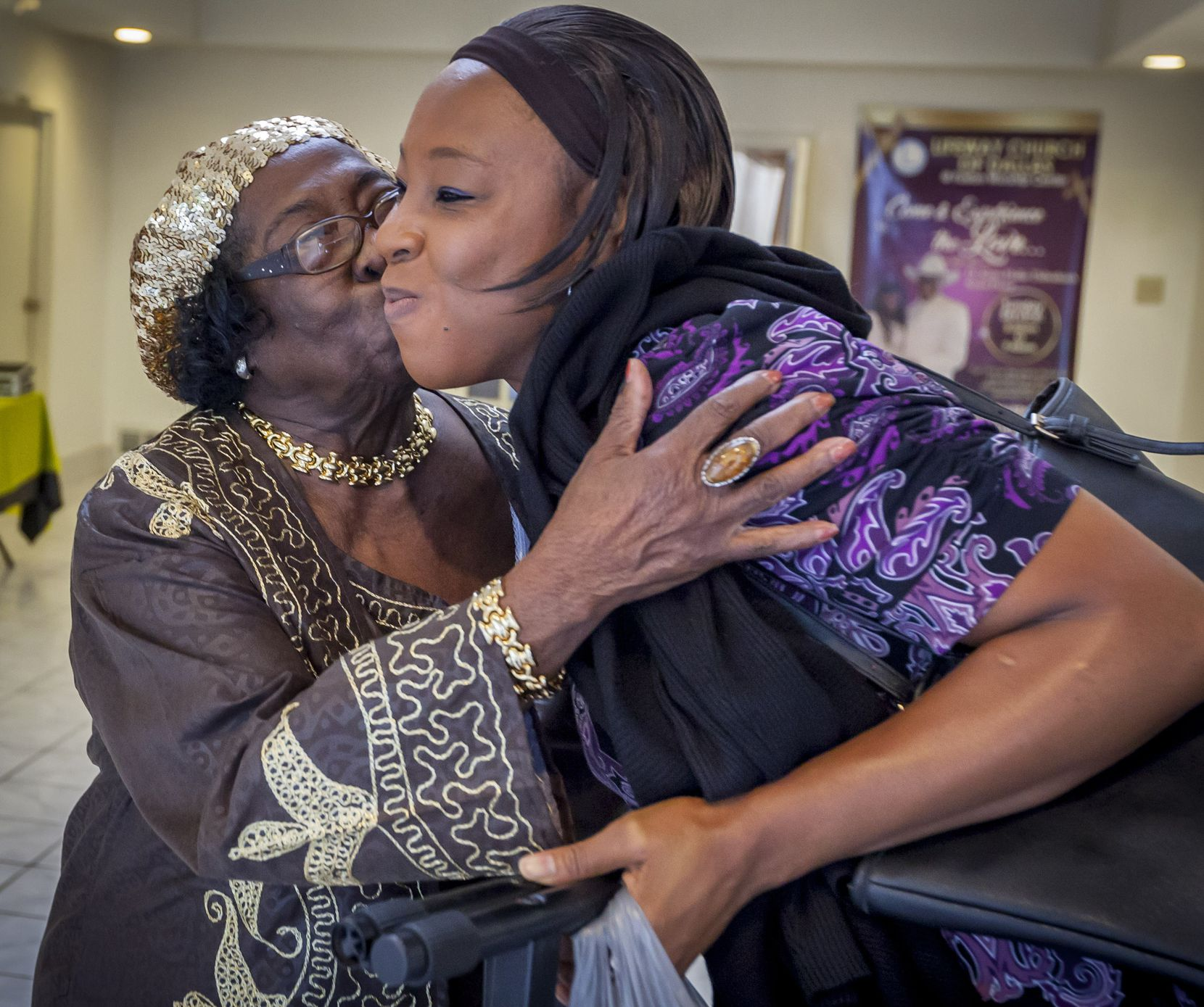 Giles kisses Salome Silombwe  at Lifeway Church in Dallas. It was at Lifeway that Giles learned she could obtain a degree.
