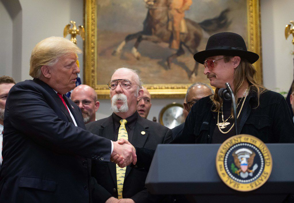 US President Donald Trump shakes hands with musician Kid Rock (R) after signing the Hatch-Goodlatte Music Modernization Act, a bipartisan bill aimed at ensuring artists who released records prior to 1972 are paid royalties from digital services, in the Roosevelt Room of the White House in Washington, DC, October 11, 2018. (Photo by SAUL LOEB / AFP)SAUL LOEB/AFP/Getty Images