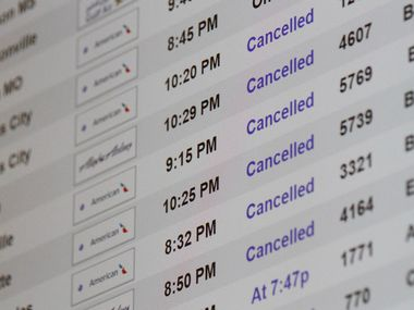 Flight cancellations for American Airlines dotted the board at DFW International Airport earlier this year.