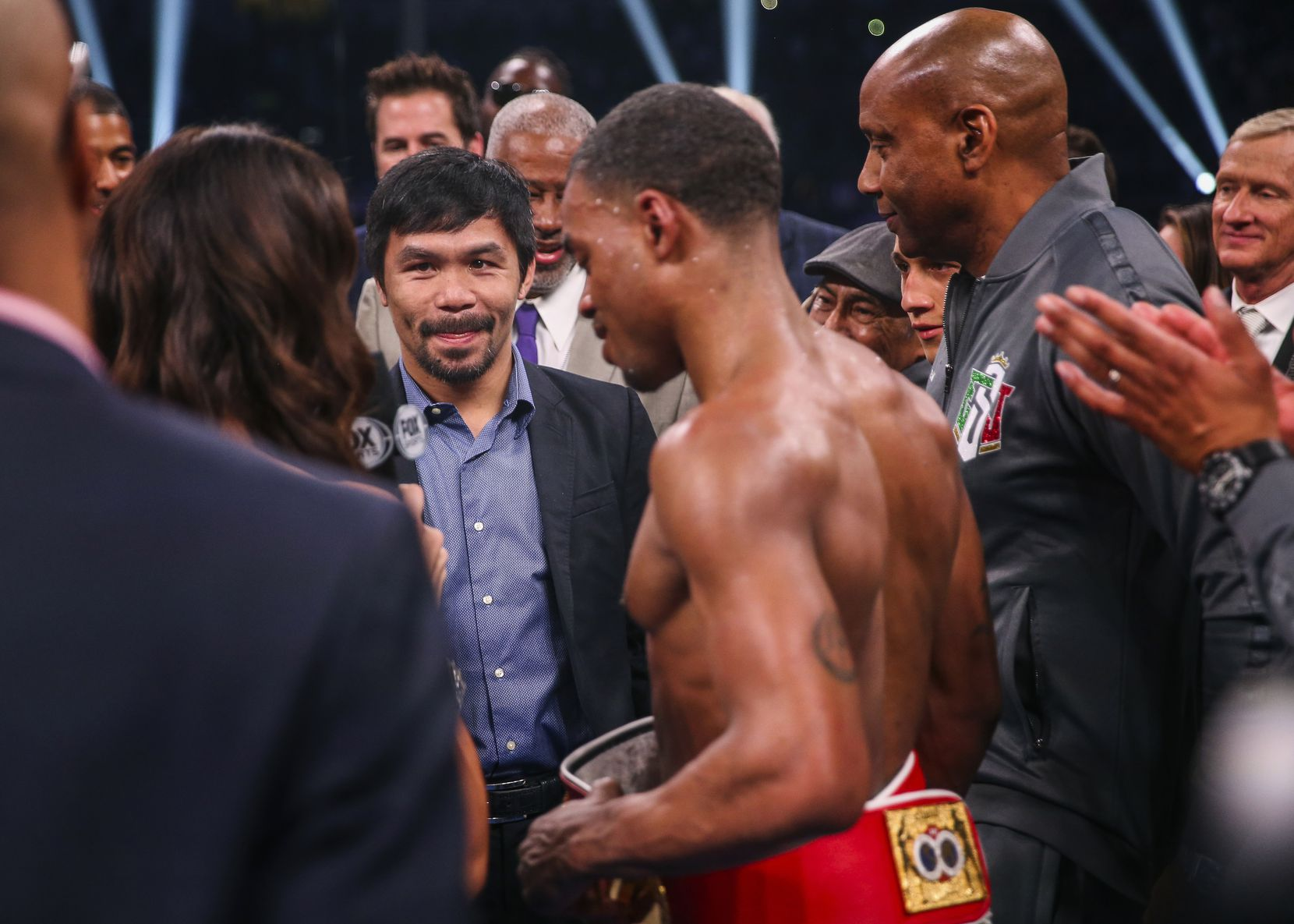 Errol Spence Jr. speaks with Manny Pacquiao onstage following his win over Mikey Garcia in a IBF World Welterweight Championship match on March 16, 2019, at AT&T Stadium in Arlington.