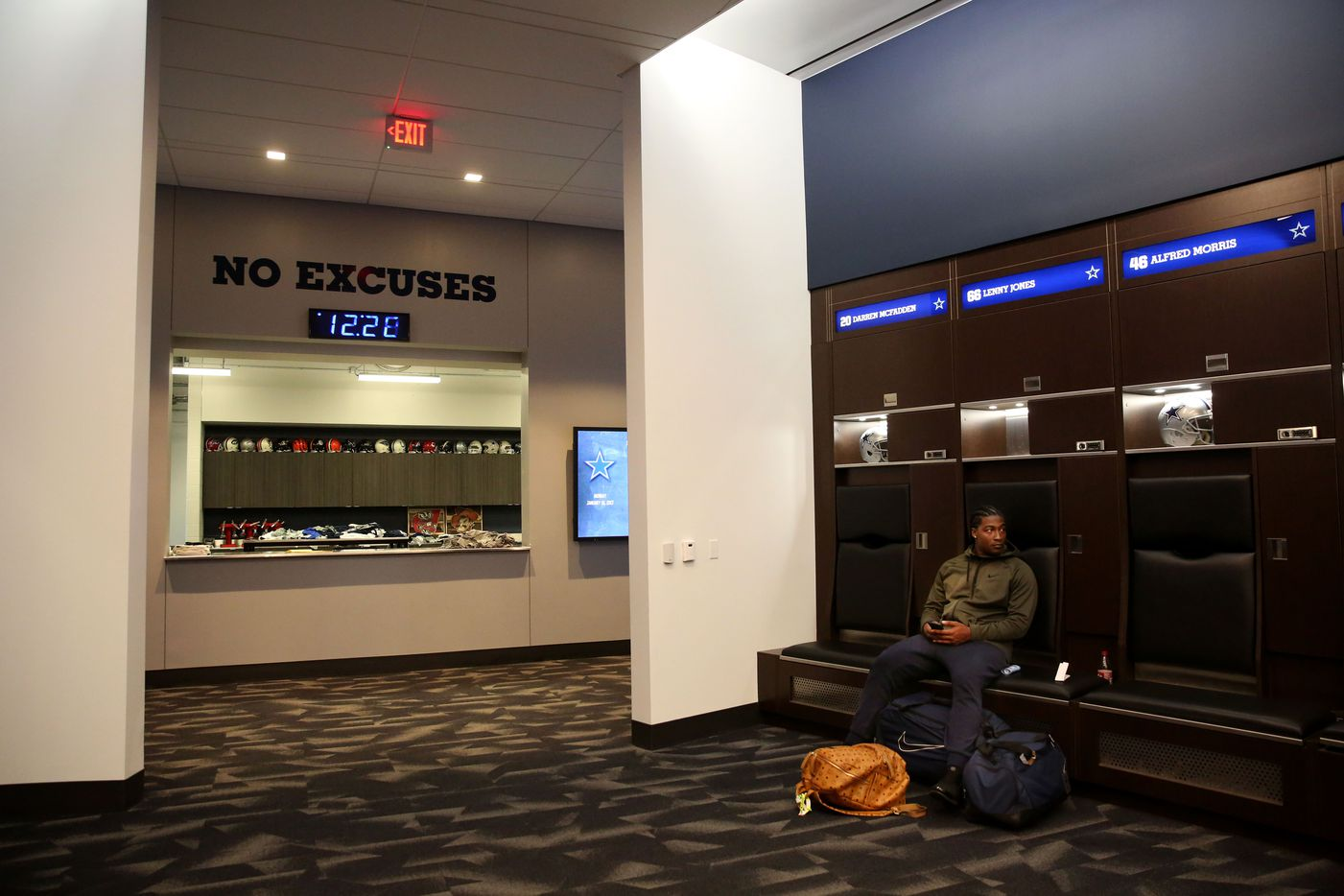 Dallas Cowboys linebacker Lenny Jones sits at his locker after cleaning it out at The Star in Frisco, Texas, on Jan. 16, 2017. The Cowboys lost against the Green Bay Packers 34-31 in the NFC divisional round playoff game, ending their 13-3 season.