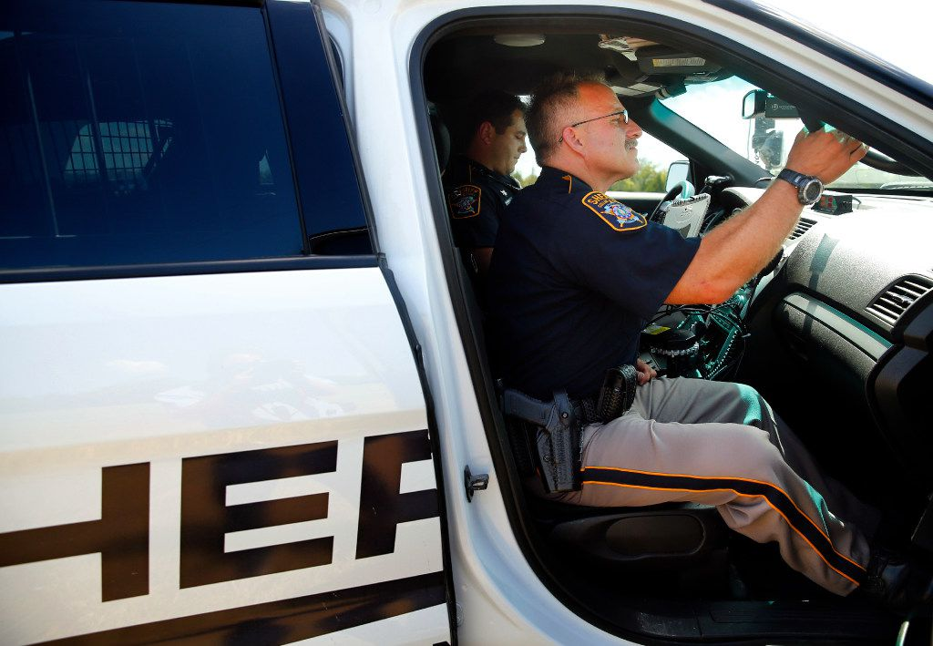 Collin County Sheriff's Deputy Kelly Reynolds keeps an eye on the driver as he and Deputy Rodney Tackett make a stop on U.S. Highway 75 in Collin County on Tuesday.