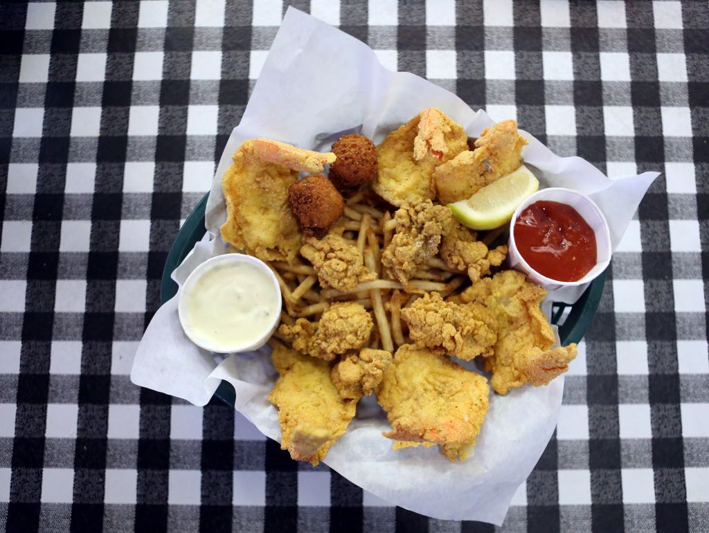 A shrimp and oyster basket is shown at Flying Fish, in Dallas, Texas, Thursday, June 7, 2013.