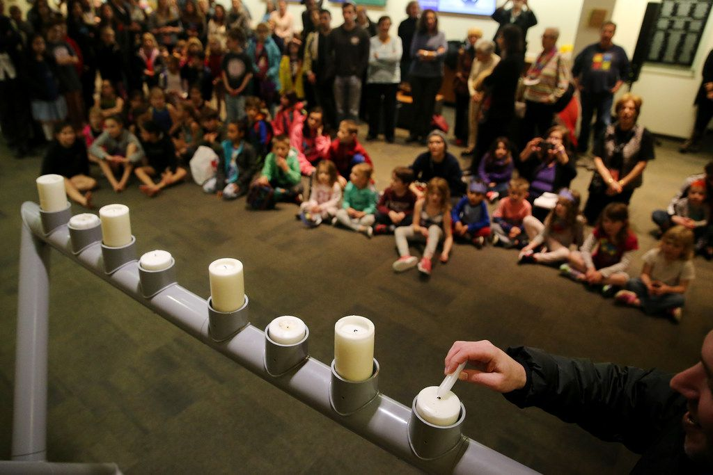 A menorah is lighted at the Aaron Family Jewish Community Center.