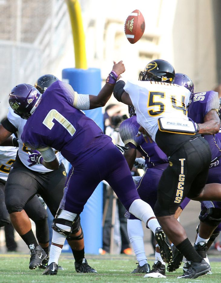 Gambling linebacker Arkez Cooper (54) hits Prairie View A&M quarterback Trey Green (7) to force a turnover during first quarter action. The two teams played in the annual State Fair Classic at the Cotton Bowl in Dallas on Sept. 26, 2015.