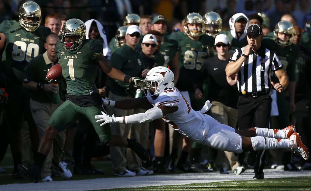 Baylor wide receiver Corey Coleman (1) is pushed out of bounds by Texas defensive back Jermaine Roberts Jr. (16) during the second half at McLane Stadium on Saturday, Dec. 5, 2015, in Waco, Texas. Texas won 23-17.