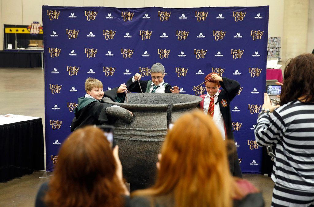 Young Harry Potter fans (from left) William Ferdinand, Travis Holmes and brother Simon Holmes pose for their mother's photos during LeakyCon, a Harry Potter convention at Kay Bailey Hutchison Convention Center in Dallas on Aug. 11, 2019.