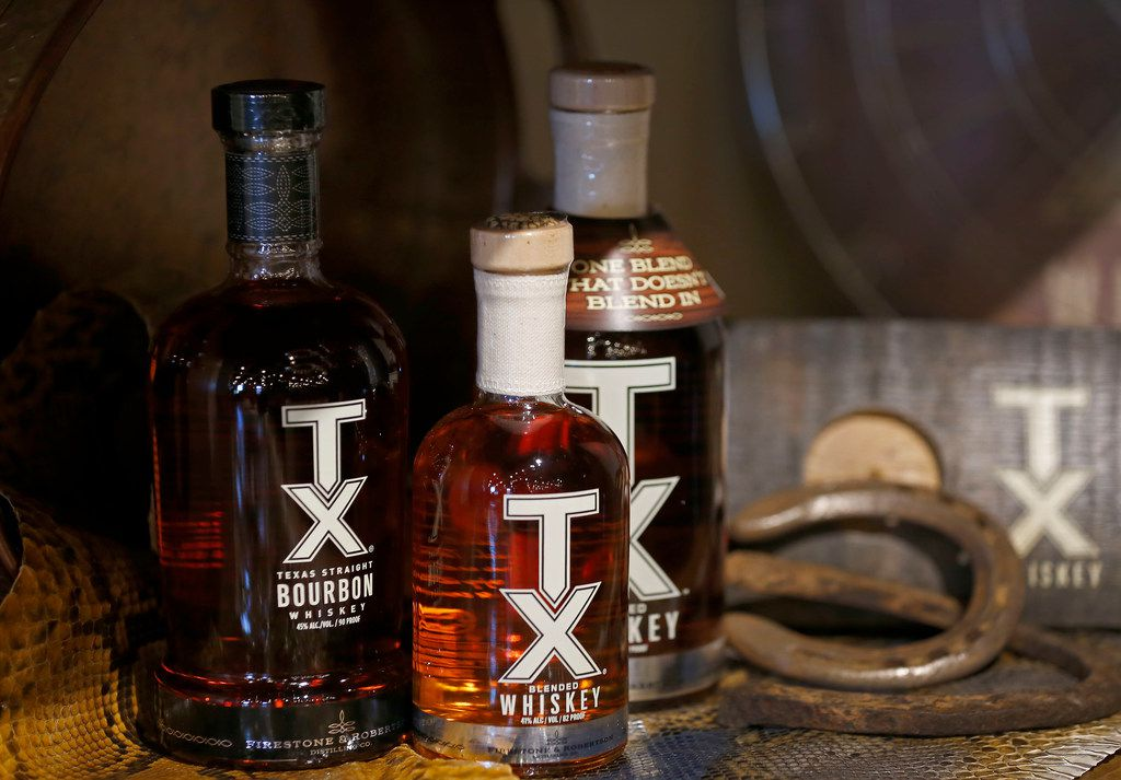 Bottles of TX Bourbon and TX Whiskey for sale inside the Ranch Store at the Firestone & Robertson Distilling Co.'s Whiskey Ranch.