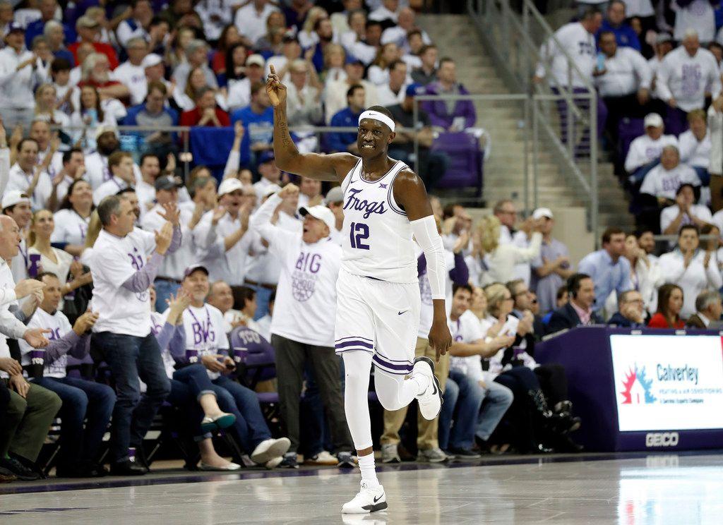 TCU forward Kouat Noi (12) celebrates sinking a three-point basket against Kansas in the first half of an NCAA college basketball game in Fort Worth, Texas, Monday, Feb. 11, 2019. (AP Photo/Tony Gutierrez)