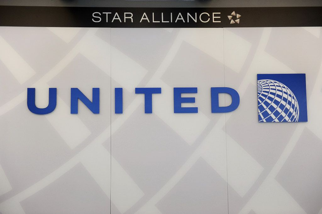 "(FILES) This file photo taken on August 13, 2013 shows a United Airlines logobehind the ticket counter at Chicago's O'Hare airport. Social media anger sparked by footage of United Airlines forcibly removing a passenger from an overbooked flight showed no signs of abating on April 11, 2017, with calls for a boycott of the US carrier. The videos taken on the plane and posted to Twitter showed the man, reportedly identified by another passenger as ethnically Chinese, being forcibly pulled screaming from his seat by three security personnel.United addressed the incident in a statement posted on its website on April 10, 2017. ""This is an upsetting event to all of us,"" said chief executive Oscar Munoz, noting that the airline was conducting a ""detailed review of what happened.""  / AFP PHOTO / MIRA OBERMANMIRA OBERMAN/AFP/Getty Images"