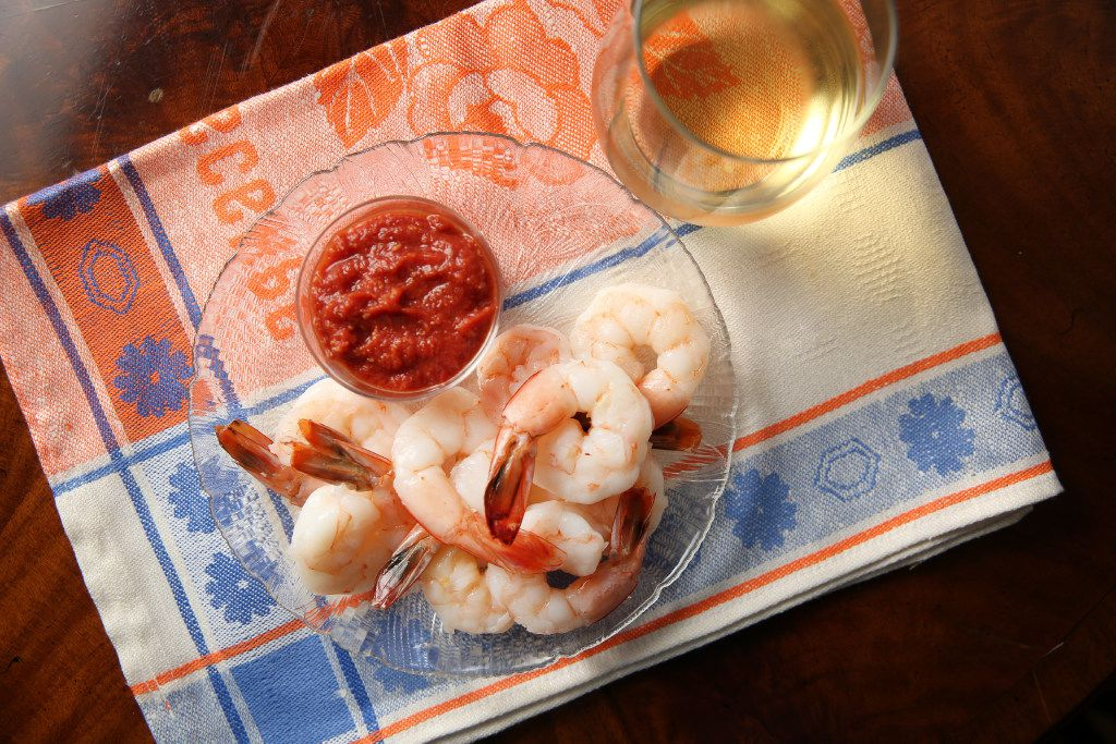 Texas gulf shrimp cocktail paired with wine. (Rose Baca/Staff Photographer)