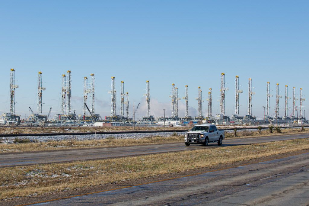 FILE - In this Wednesday, Feb. 25, 2015, file photo, more than 30 oil drilling rigs are idle in a Helmerich & Payne, Inc. yard in Odessa, Texas (Courtney Sacco/Odessa American via AP)