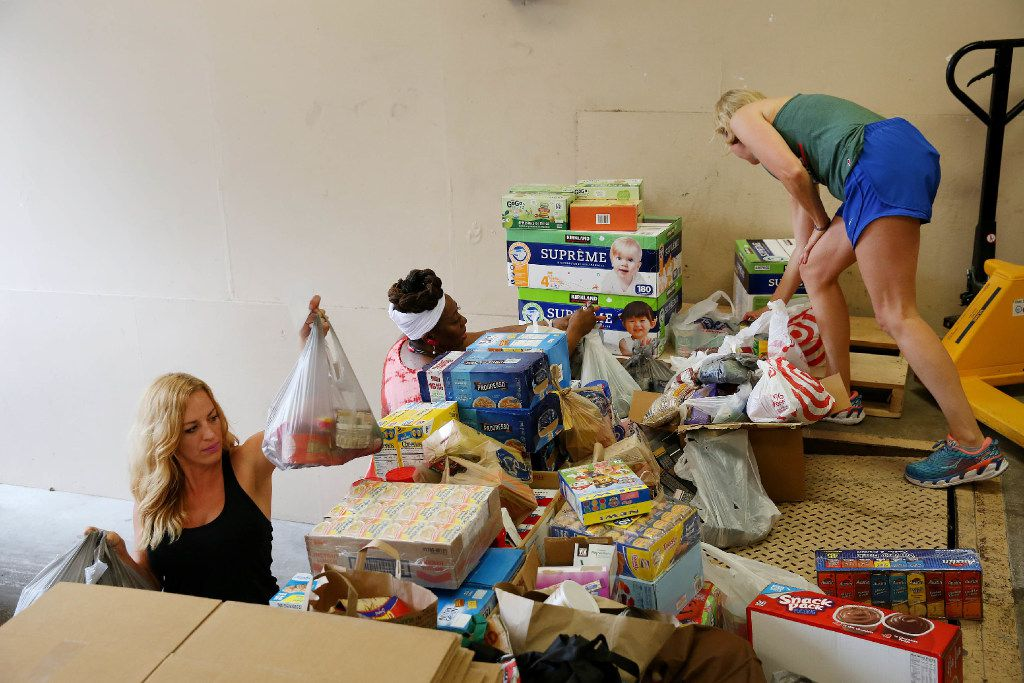 (From left) Taylor Grey, community relations director at Trusted World, Betty Reynolds of Christian Chapel Temple of Faith in Dallas, and volunteer Rebecca Wilson organize donations for Hurricane Harvey relief.
