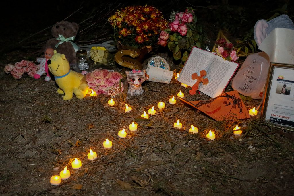 Artificial candles are part of a small tribute set up for three-year-old Sherin Matthews on Thursday October 12, 2017. Sherin went missing from an alley behind her house in Richardson, Texas on Saturday, October 7, 2017. (Ron Baselice/The Dallas Morning News)