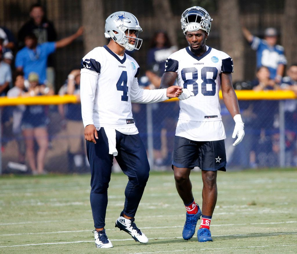 Dallas Cowboys quarterback Dak Prescott (4) talks to Dallas Cowboys wide receiver Dez Bryant (88) after connecting on a deep play during the afternoon practice at training camp in Oxnard, California on Monday, July 24, 2017. (Vernon Bryant/The Dallas Morning News)