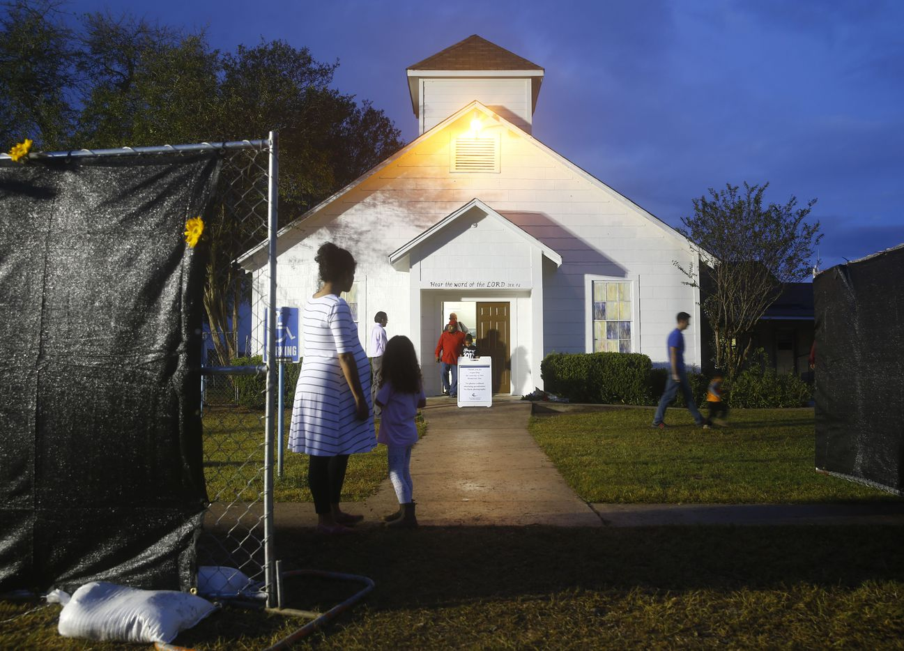 Visitors file out after they are allowed into First Baptist Church to pay their respects a week after the shooting in Sutherland Springs, Texas on Nov. 12, 2017. The church was the site of a shooting that killed 26 and left 30 injured.