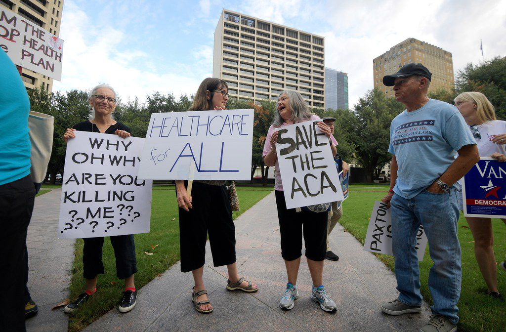 Supporters of the Affordable Care Act protest during a rally at Burnett Park in Fort Worth on Sept. 5, 2018.  Democratic nominee for Texas Attorney General  Justin Nelson hosted the Fort Worth Rally for Pre-existing Coverage Protection.