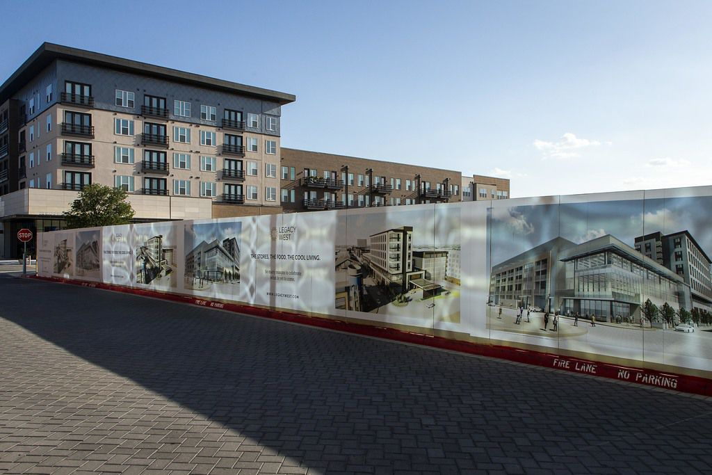Fencing surrounds construction at the Legacy West mixed-use development this month in Plano.