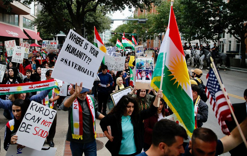 Protesters against the pulling of troops in Syria rally at the site of the Keep America Great Rally for President Donald Trump at the American Airlines Center in Dallas, on Thursday, October 17, 2019.
