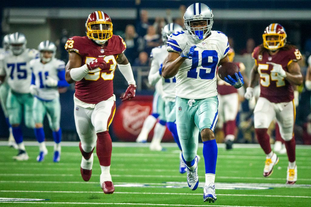 Dallas Cowboys wide receiver Amari Cooper (19) breaks away from Washington Redskins inside linebacker Zach Brown (53) on a 90-yard touchdown catch-and-run during the third quarter of an NFL football game at AT&T Stadium on Thursday, Nov. 22, 2018, in Arlington.