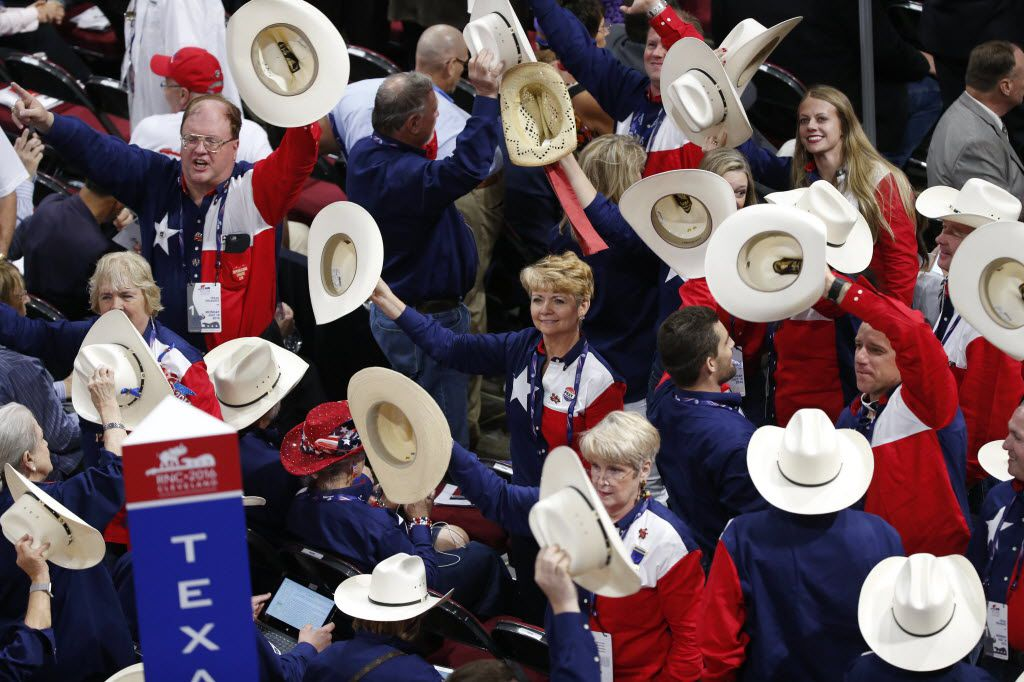 Texas delegates wave their hats to music during the first day of the Republican National Convention. The hats, which were donated by a Houston couple, retail for $95 each.