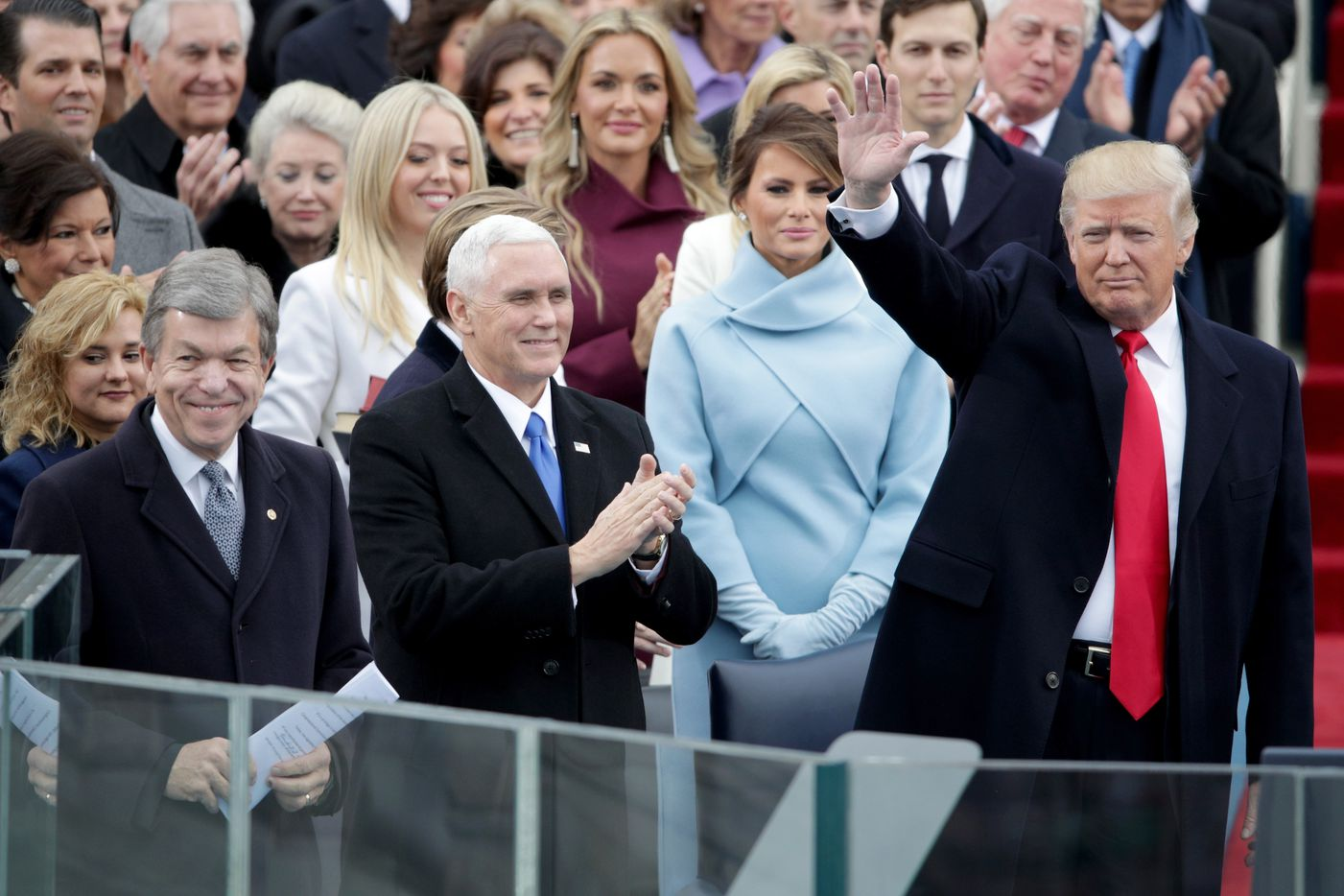 WASHINGTON, DC - JANUARY 20: President Elect Donald Trump waves to spectators as Vice President Elect Mike Pence and Melania Trump look on at the West Front of the U.S. Capitol on January 20, 2017 in Washington, DC. In today's inauguration ceremony Donald J. Trump becomes the 45th president of the United States.