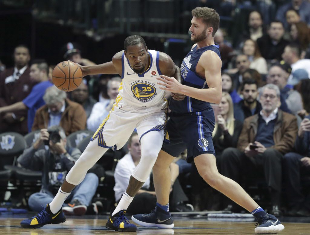 Golden State Warriors forward Kevin Durant (35) dribbles against Dallas Mavericks forward Maximilian Kleber (42) during the second half of an NBA basketball game in Dallas, Wednesday, Jan. 3, 2018. (AP Photo/LM Otero)