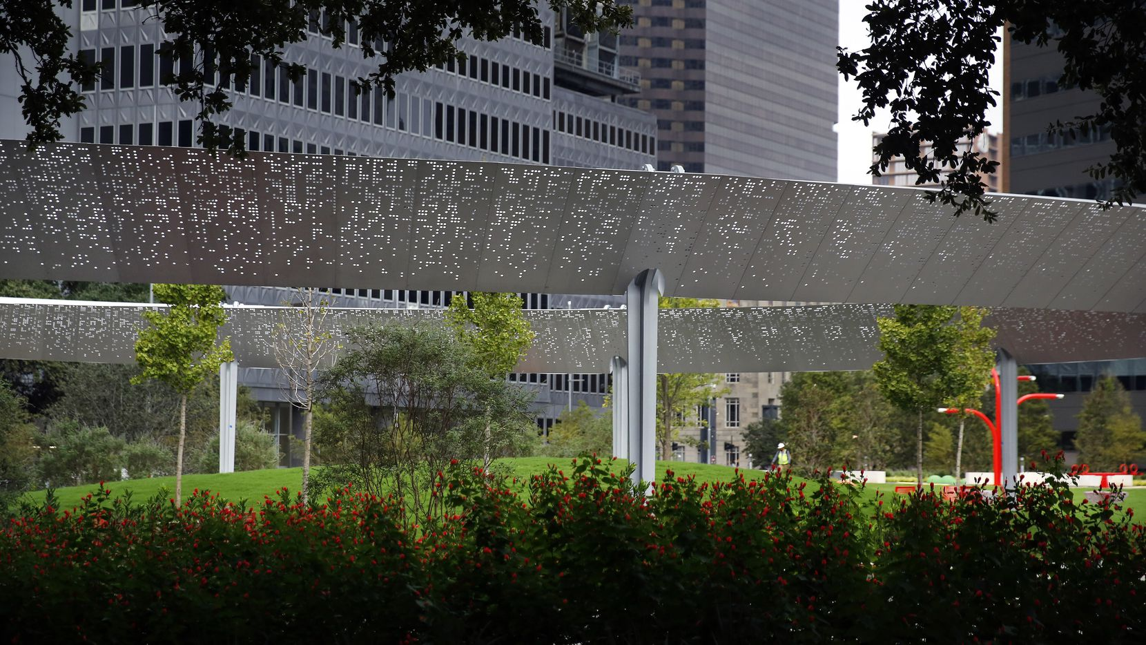 The Pavilion, a floating ovoid structure of stainless steel designed by HKS Architects, is pictured from Pacific Plaza's Aston Grove,  a garden of 23 mature live oaks that were preserved from a tiny 1980s-era green space.