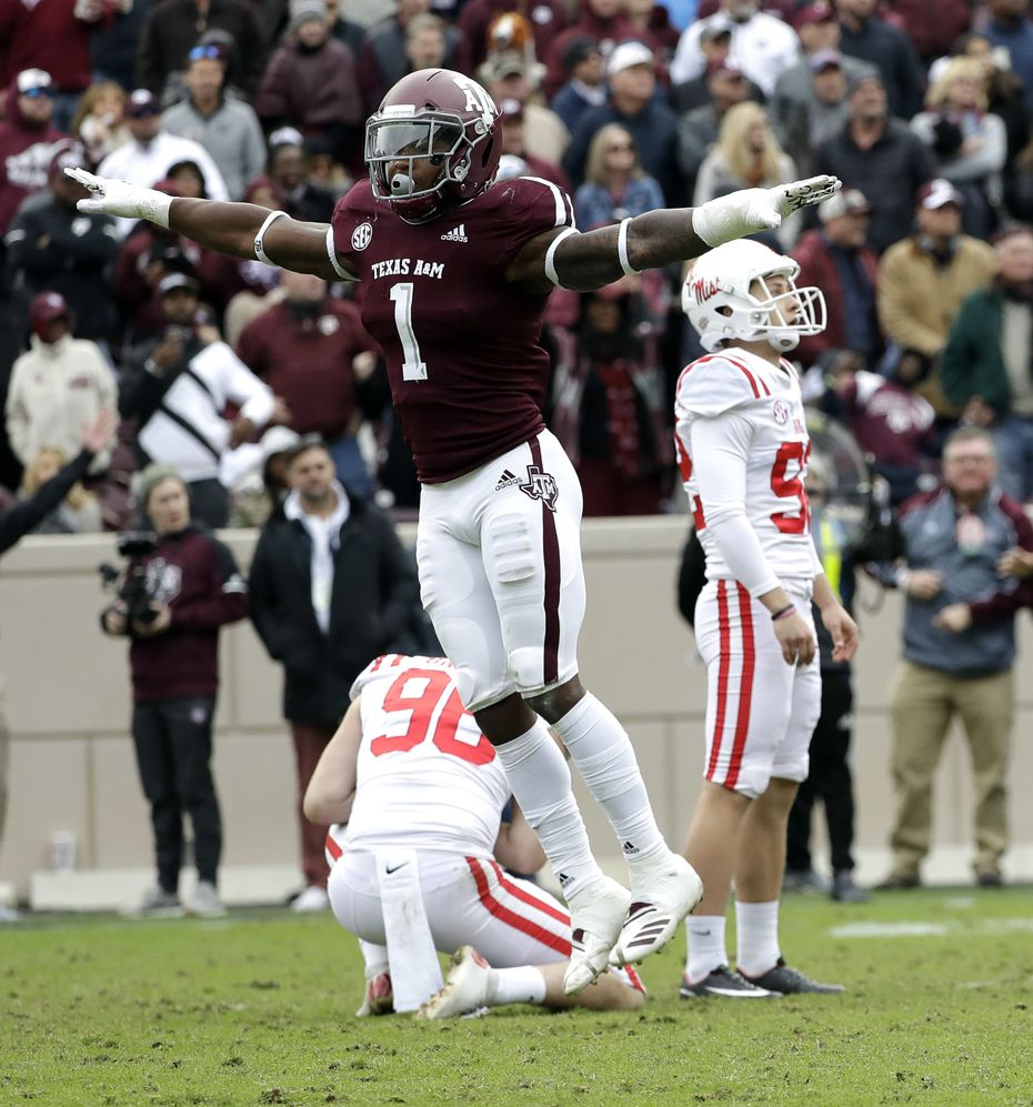 FILE - Texas A&M linebacker Buddy Johnson (1) celebrates after Mississippi kicker Luke Logan, right, missed a field goal during the fourth quarter of a game Saturday, Nov. 10, 2018, in College Station. (AP Photo/David J. Phillip)