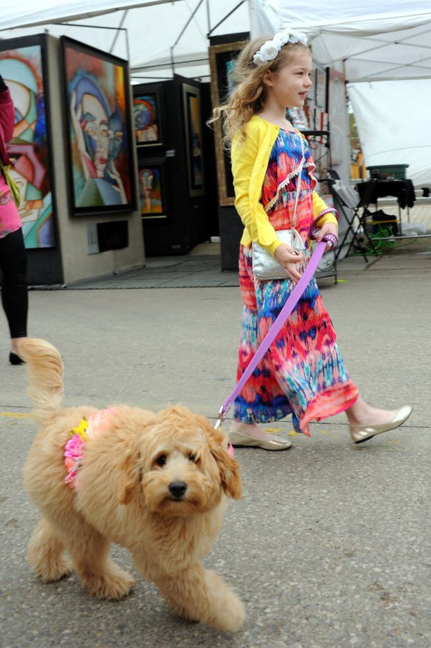 Zettie Niven and her six-month-old goldendoodle Poppy took a stroll in the parade.