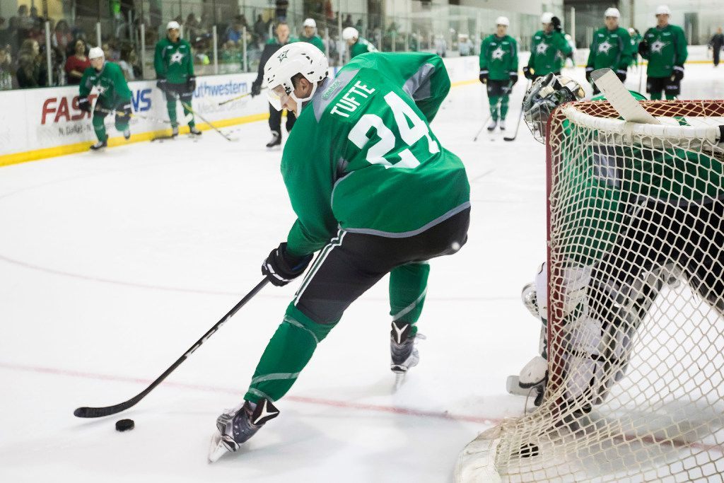 Forward Riley Tufte (24) works against goalie Landon Bow on the first day of Dallas Stars development camp at the Dr Pepper StarCenter on Saturday, July 8, 2017, in Frisco. (Smiley N. Pool/The Dallas Morning News)