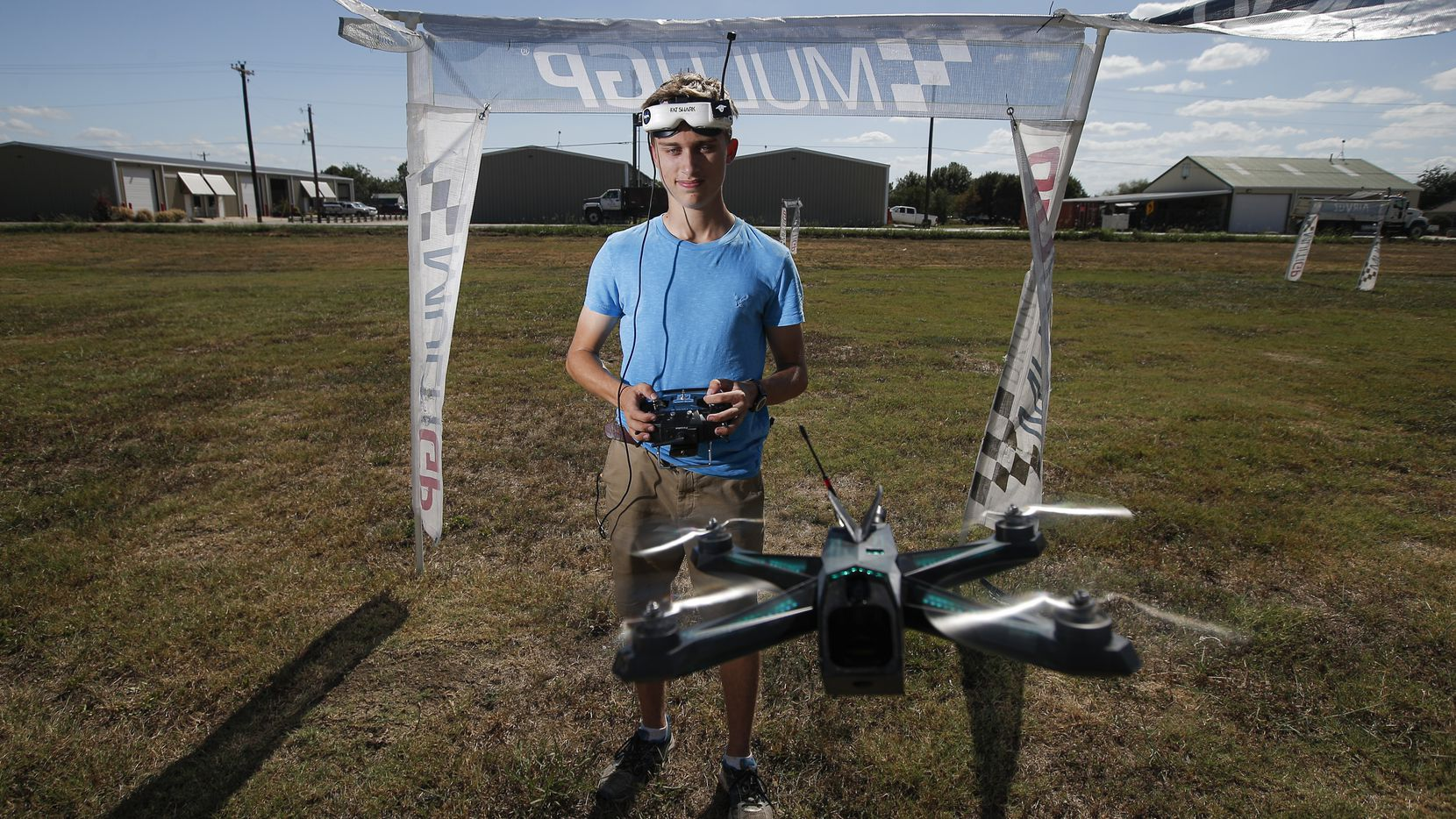 Professional drone pilot Alex Vanover poses for a photo with one of his racing drones at the Northwest Regional Airport in Roanoke, Tuesday, October 1, 2019. Vanover is one of the top pilots in the Drone Racing League.