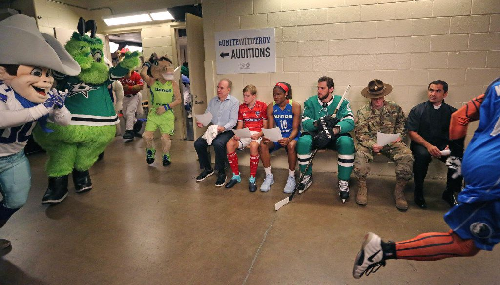 Roger Staubach, FC Dallas' Paxton Pomykal, Dallas Wings' Kaela Davis, Dallas Stars' Tyler Seguin, Christopher Lee Herod of the US Army, and Dan Aptor of the United Way, seated left to right, watch as local sports mascots run by during the filming of a public service announcement for United Way of Metropolitan Dallas at the American Airlines Center in Dallas on Monday, August 7, 2017. (Louis DeLuca/The Dallas Morning News)