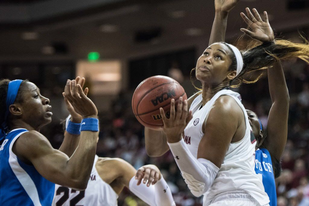 South Carolina center Alaina Coates, right, drives to the hoop against Kentucky forward Evelyn Akhator, left,  during the second half of an NCAA college basketball game Thursday, Feb. 5, 2016, in Columbia, S.C. (AP Photo/Sean Rayford)