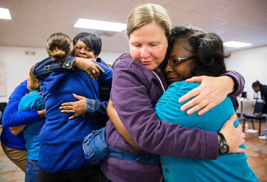 """EXCHANGE-EMERGENCY SHELTER DALLAS --  Carol Gordon, second from right, hugs Teresa D., right, while Kristie Loveland, left, hugs Florence Graves, second from left, during a group session at the Austin Street Center's women's day resource program called """"The Sisterhood"""" on Tuesday, January 17, 2017 at Austin Street Center in Dallas. The program addresses the challenges of homeless women. (Ashley Landis/The Dallas Morning News)"""