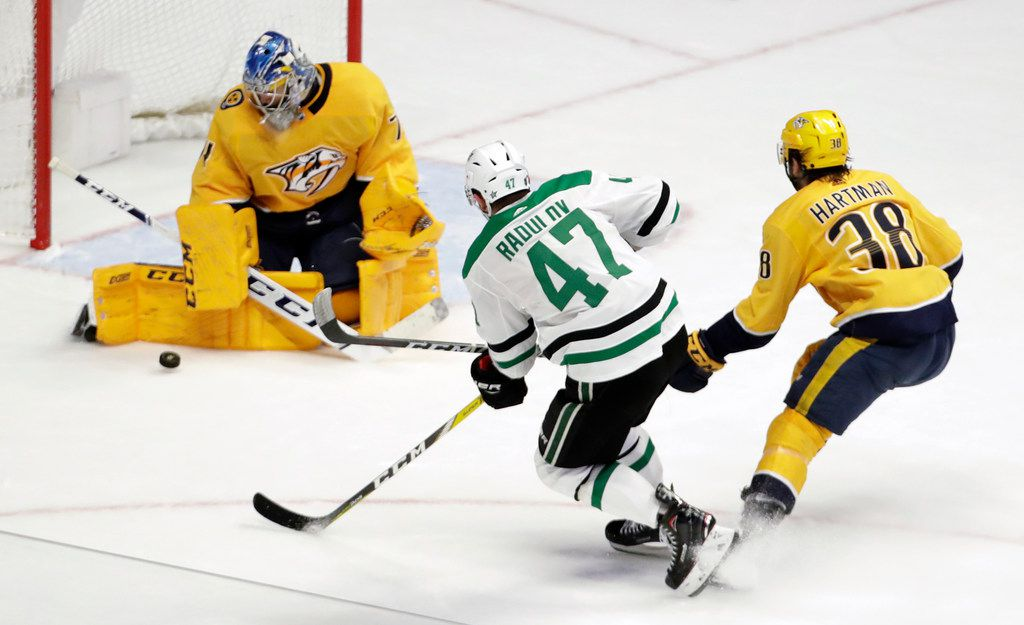 Nashville Predators goaltender Juuse Saros (74), of Finland, blocks a shot by Dallas Stars right wing Alexander Radulov (47), of Russia, during the third period of an NHL hockey game Thursday, Feb. 7, 2019, in Nashville, Tenn. The Predators won 3-2 in overtime. (AP Photo/Mark Humphrey)