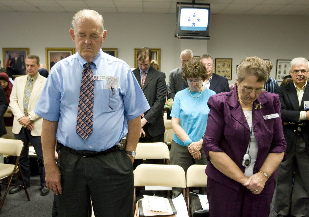 Anthony Bruner and Mary Lou Bruner pray at the start of a meeting in Austin of the Texas State Board of Education to discuss Islam and Christianity in textbooks. (Jay Janner/Austin American-Statesman)