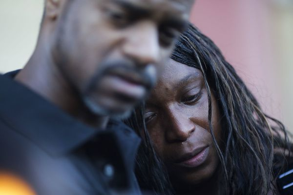 Sherry James, mother of 16-year-old Shania Gray,  is comforted at a candlelight vigil.
