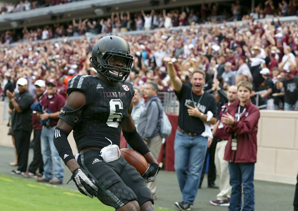 Texas A&M Aggies defensive back Donovan Wilson (6) runs a 60 yard interception for a touchdown in a game against the South Carolina Gamecocks during the second half of play at Kyle Field in College Station, on Saturday, October 31, 2015. Texas A&M Aggies defeated South Carolina Gamecocks 35-28. (Vernon Bryant/The Dallas Morning News)