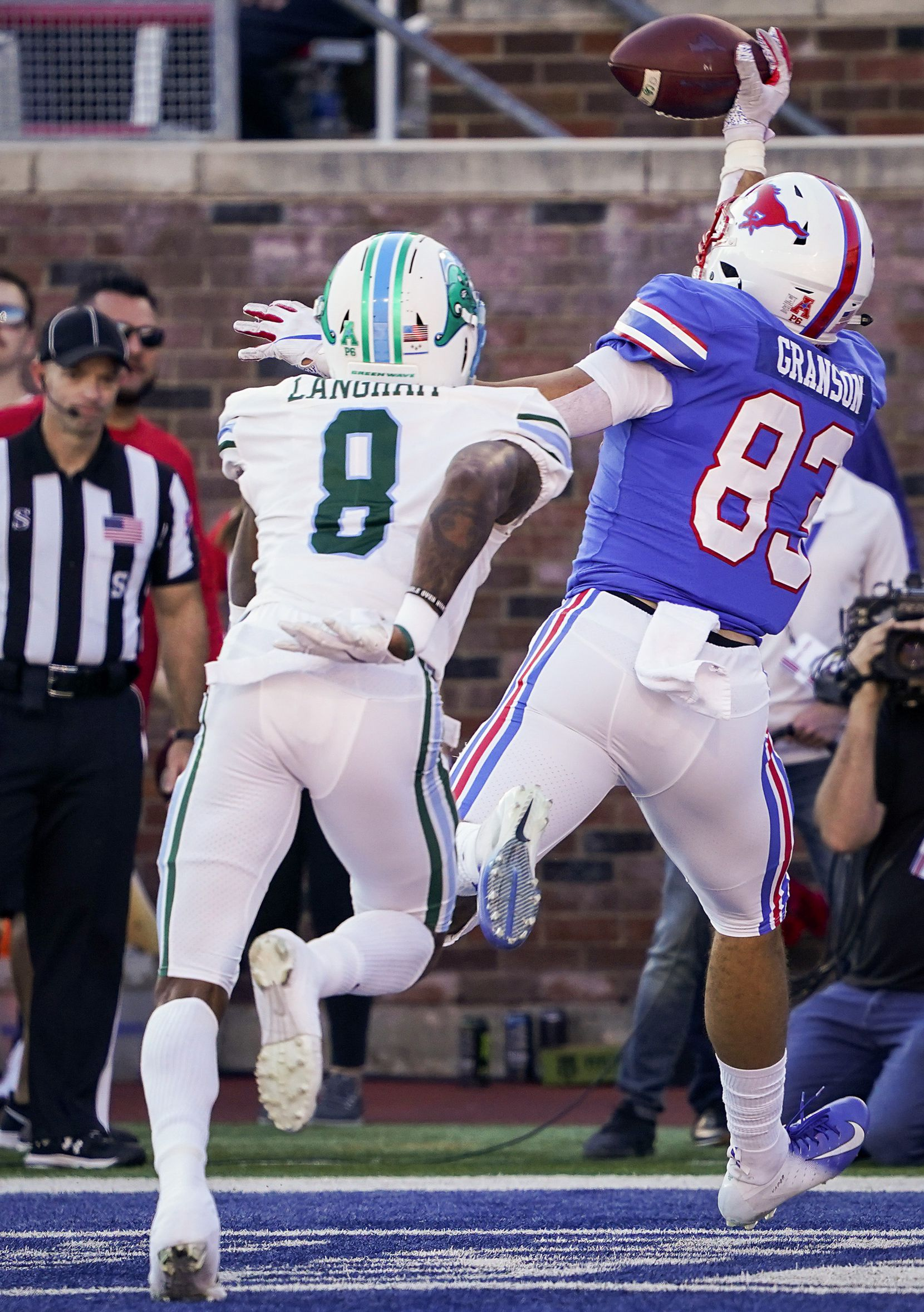 SMU tight end Kylen Granson (83) makes catch on a 8-yard touchdown pass as Tulane quarterback Josh Coltrin (8) defends during the first half of an NCAA football game at Ford Stadium on Saturday, Nov. 30, 2019, in Dallas.