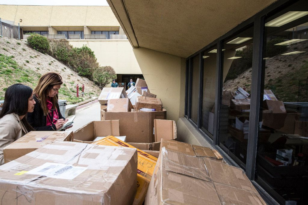 Stacked shipments of H-1B visa petitions outside a government processing center in Laguna Niguel, Calif., on April 3, 2017. (Eros Hoagland/The New York Times)