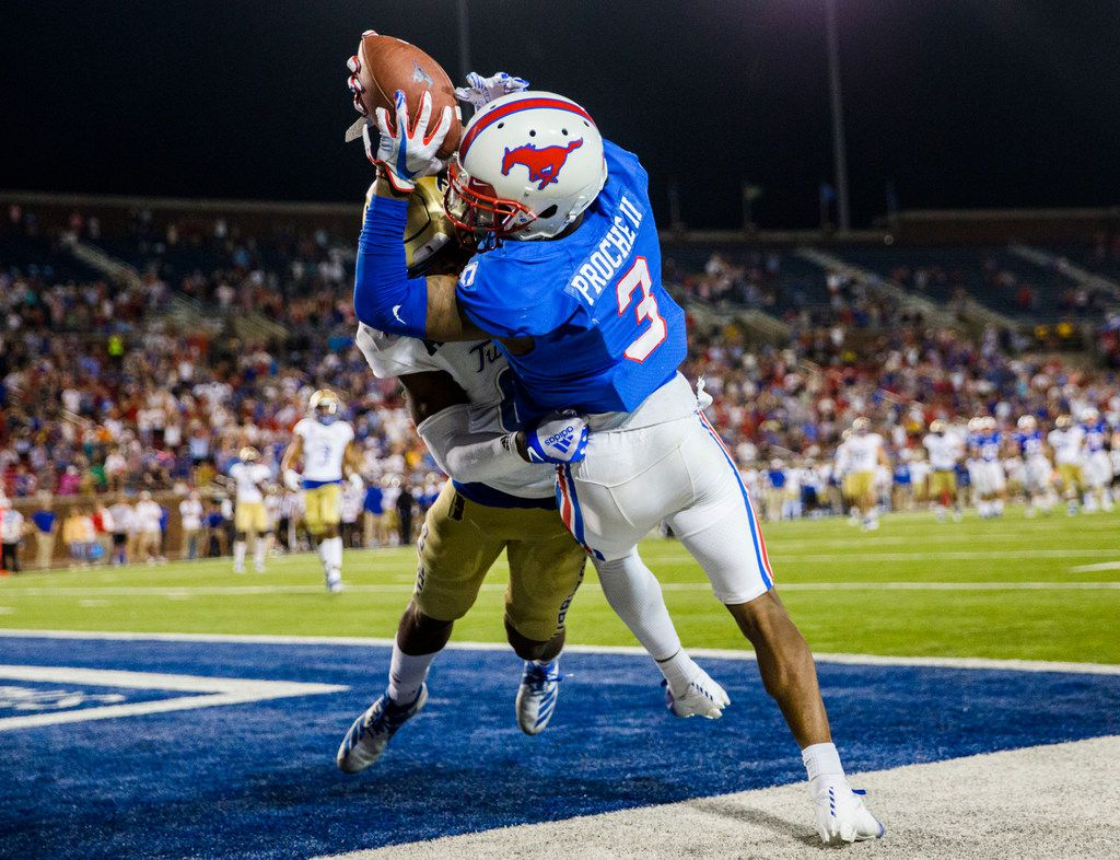 SMU Mustangs wide receiver James Proche (3) catches a pass in the end zone for a 43-37 win over Tulsa Golden Hurricane in triple overtime on Saturday, October 5, 2019 at Ford Stadium on the SMU campus in Dallas. Tulsa Golden Hurricane safety Brandon Johnson (8) defended. (Ashley Landis/The Dallas Morning News)