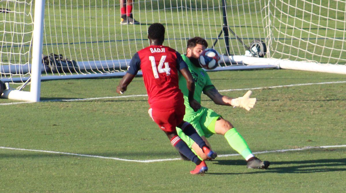 Dominic Badji's attempt on goal is denied by OKC Energy goalkeeper Cody Laurendi. (6-12-19)